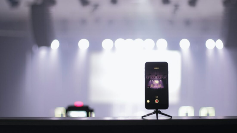 A cell phone is set up to record a virtual experience