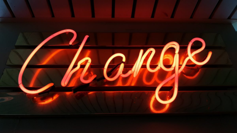 A neon sign that says 'change'