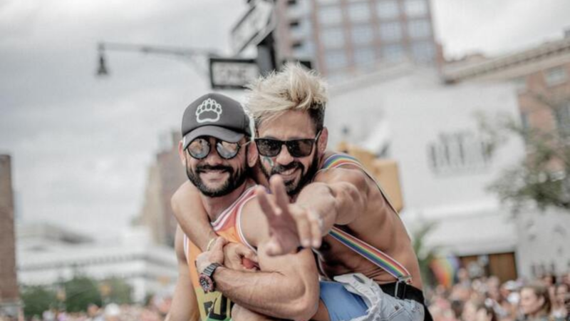 A gay couple poses for the camera