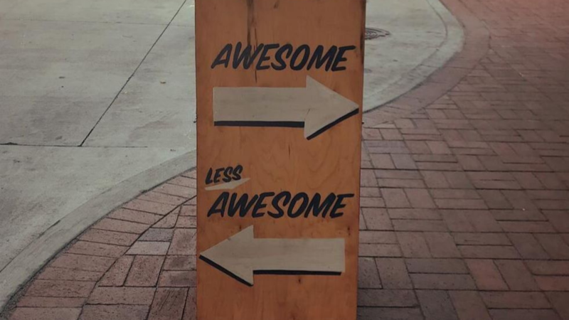 """A wooden side reads """"Awesome, this way"""""""
