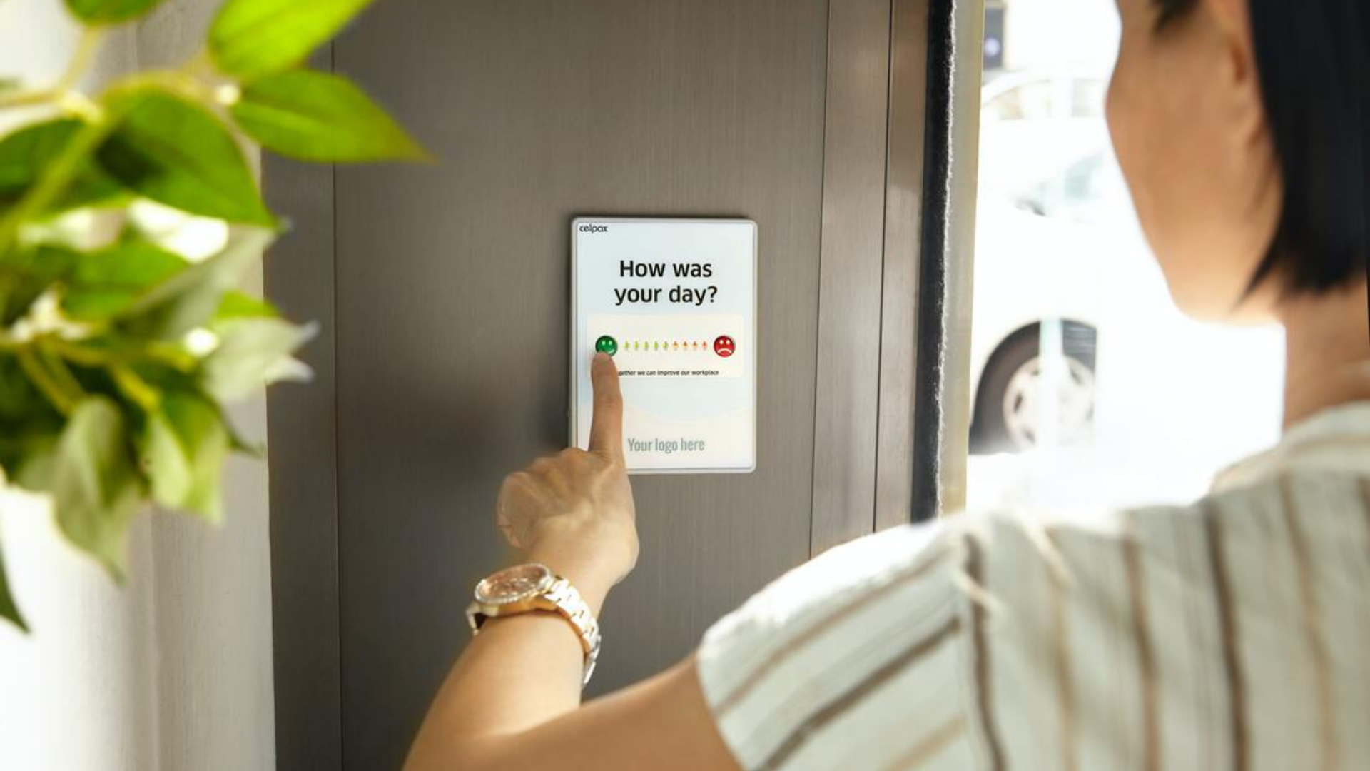 A customer gives feedback using a button on the wall