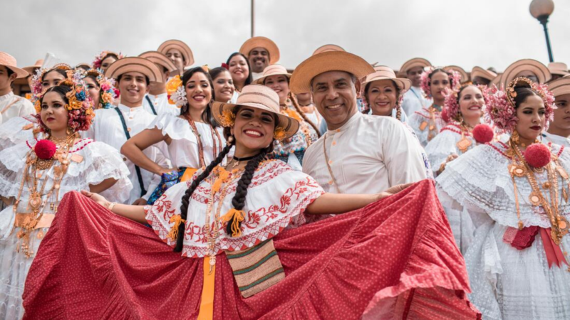 A South American guide team is dressed in traditional folk costumes