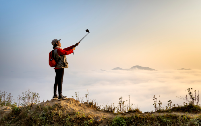 A guide uses a selfie stick to do a virtual tour